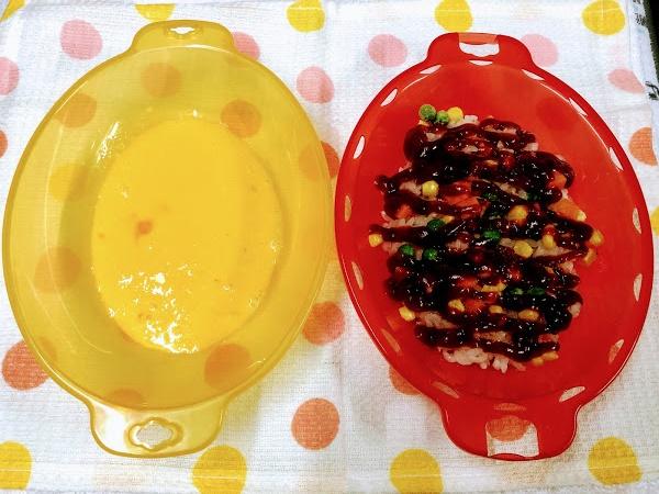 具が入った赤色と黄色の容器の写真